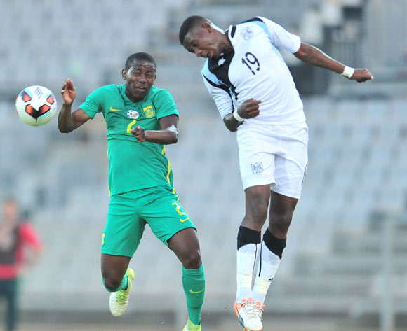 Thabo Cele of South Africa challenged by Tumisang Orebonye of Botswana during 2017 Cosafa Castle Cup match between Botswana and South Africa at Moruleng Stadium in Rustenburg on 04 July 2017 ©Samuel Shivambu/BackpagePix
