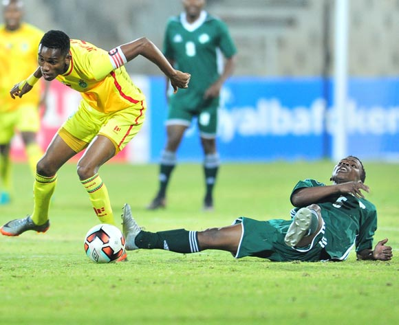 Kefuoe Mahula of Lesotho challenged by Ovidy Karuru of Zimbabwe during 2017 Cosafa Castle Cup match between Lesotho and Zimbabwe at Moruleng Stadium in Rustenburg on 05 July 2017 ©Samuel Shivambu/BackpagePix