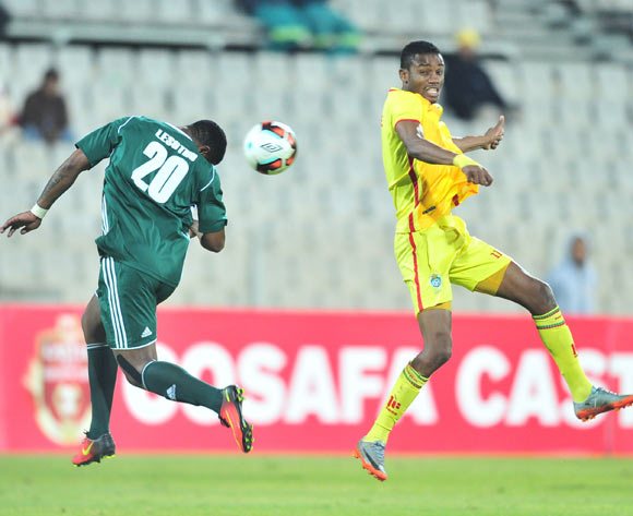 Thapelo Mokhehle of Lesotho challenged by Ovidy Karuru of Zimbabwe during 2017 Cosafa Castle Cup match between Lesotho and Zimbabwe at Moruleng Stadium in Rustenburg on 05 July 2017 ©Samuel Shivambu/BackpagePix