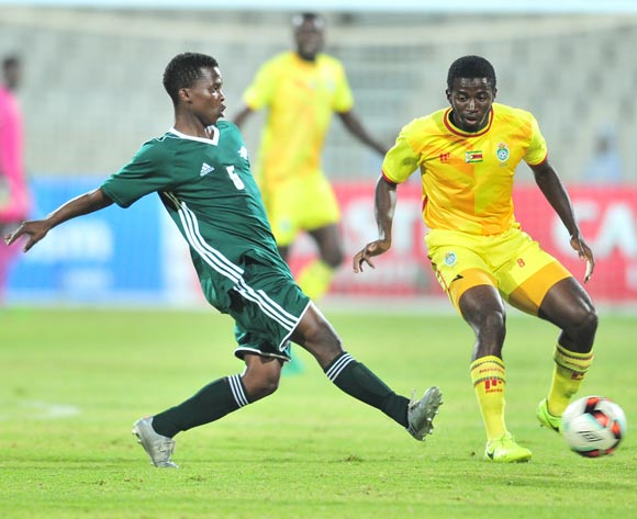 John Takwara of Zimbabwe challenged by Kefuoe Mahula of Lesotho during 2017 Cosafa Castle Cup match between Lesotho and Zimbabwe at Moruleng Stadium in Rustenburg on 05 July 2017 ©Samuel Shivambu/BackpagePix