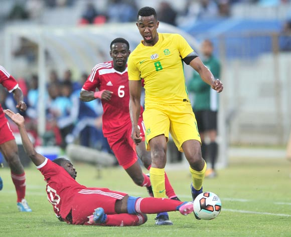 Lehlogonolo Masalesa of South Africa tackled by Wangu Gome of Namibia challenged during 2017 Cosafa Castle Cup match between South Africa and Namibia at Moruleng Stadium in Rustenburg on 07 July 2017 ©Samuel Shivambu/BackpagePix