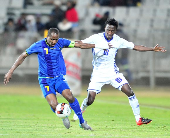 Himid Mkami of Tanzania challenged by Tumelo Khutlang of Lesotho during 2017 Cosafa Castle Cup match between Tanzania and Lesotho at Moruleng Stadium in Rustenburg on 07 July 2017 ©Samuel Shivambu/BackpagePix
