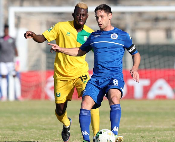 Dean Furman of Supersport United challenged by Nathanael Bongo Mbourou of  CF Mounana during the 2017 CAF Confederations Cup match between Supersport United and CF Mounana at the Lucas Moripe Stadium, Atteridgeville South Africa on 08 July 2017 ©Muzi Ntombela/BackpagePix
