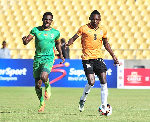 Lawrence Chungu of Zambia challenged by Talent Chawapiwa of Zimbabwe during 2017 Cosafa Castle Cup match between Zambia and Zimbabwe at Royal Bafokeng Stadium in Rustenburg on 09 July 2017 ©Samuel Shivambu/BackpagePix