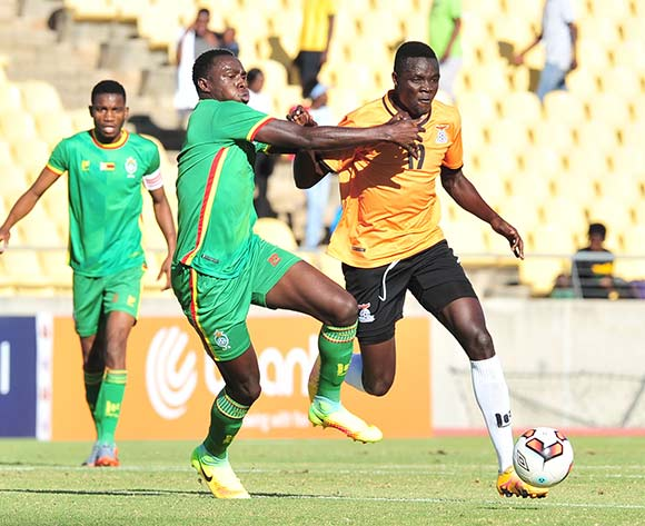 Jackson Chirwa of Zambia challenged by Liberty Chakoroma of Zimbabwe during 2017 Cosafa Castle Cup match between Zambia and Zimbabwe at Royal Bafokeng Stadium in Rustenburg on 09 July 2017 ©Samuel Shivambu/BackpagePix