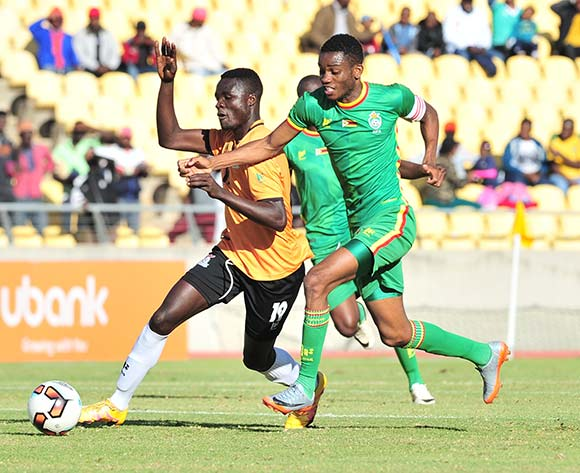 Jackson Chirwa of Zambia challenged by Ovidy Karuru of Zimbabwe during 2017 Cosafa Castle Cup match between Zambia and Zimbabwe at Royal Bafokeng Stadium in Rustenburg on 09 July 2017 ©Samuel Shivambu/BackpagePix