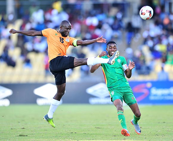 Ovidy Karuru of Zimbabwe challenged by Donashano Malama of Zambia during 2017 Cosafa Castle Cup match between Zambia and Zimbabwe at Royal Bafokeng Stadium in Rustenburg on 09 July 2017 ©Samuel Shivambu/BackpagePix