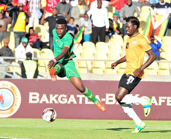 Knox Mutizwa of Zimbabwe challenged by Issac Shamujompa of Zambia during 2017 Cosafa Castle Cup match between Zambia and Zimbabwe at Royal Bafokeng Stadium in Rustenburg on 09 July 2017 ©Samuel Shivambu/BackpagePix
