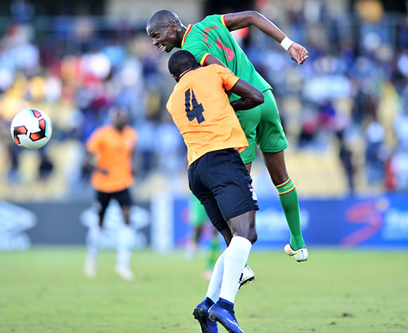 Ocean Mushure of Zimbabwe challenged by Adrian Chama of Zambia during 2017 Cosafa Castle Cup match between Zambia and Zimbabwe at Royal Bafokeng Stadium in Rustenburg on 09 July 2017 ©Samuel Shivambu/BackpagePix
