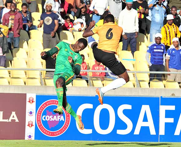 Talent Chawapiwa of Zimbabwe challenged by Bonston Muchindu of Zambia during 2017 Cosafa Castle Cup match between Zambia and Zimbabwe at Royal Bafokeng Stadium in Rustenburg on 09 July 2017 ©Samuel Shivambu/BackpagePix