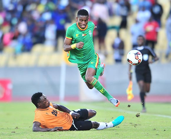 Ovidy Karuru of Zimbabwe tackled by Webster Mulenga of Zambia during 2017 Cosafa Castle Cup match between Zambia and Zimbabwe at Royal Bafokeng Stadium in Rustenburg on 09 July 2017 ©Samuel Shivambu/BackpagePix