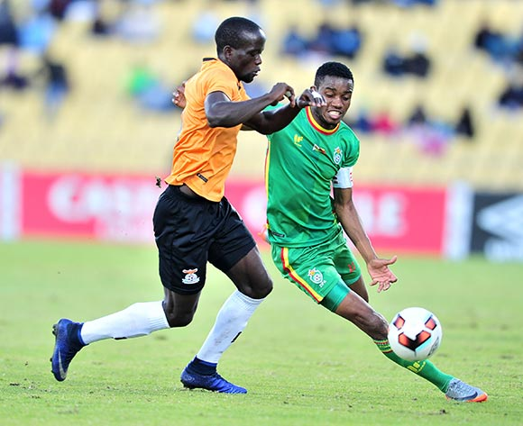 Ovidy Karuru of Zimbabwe tackled by Adrian Chama of Zambia during 2017 Cosafa Castle Cup match between Zambia and Zimbabwe at Royal Bafokeng Stadium in Rustenburg on 09 July 2017 ©Samuel Shivambu/BackpagePix