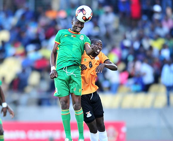 Ocean Mushure of Zimbabwe challenged by Lubinda Mundia of Zambia during 2017 Cosafa Castle Cup match between Zambia and Zimbabwe at Royal Bafokeng Stadium in Rustenburg on 09 July 2017 ©Samuel Shivambu/BackpagePix