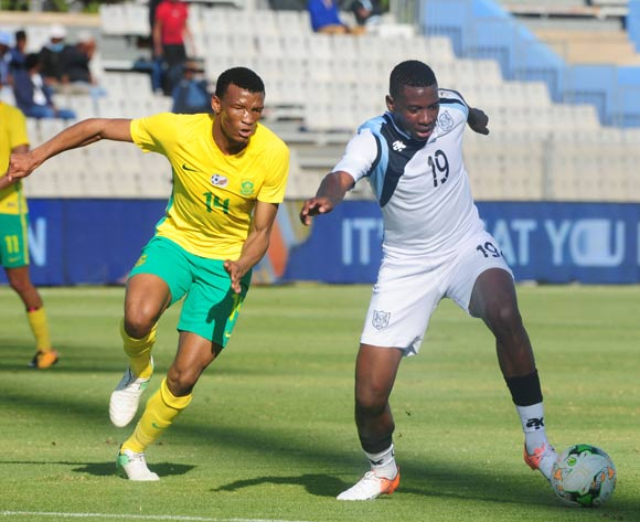Tumisang Orebonye of Botswana challenged by Mothobi Mvala of South Africa during 2018 Chan Qualifiers game between South Africa and Botswana at Moruleng Stadium on 22 July 2017 ©Aubrey Kgakatsi/BackpagePix