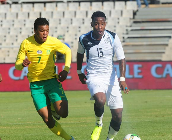 Setsile Thero of Botswana challenged by Sipho Mbule of South Africa during 2018 Chan Qualifiers game between South Africa and Botswana at Moruleng Stadium on 22 July 2017 ©Aubrey Kgakatsi/BackpagePix
