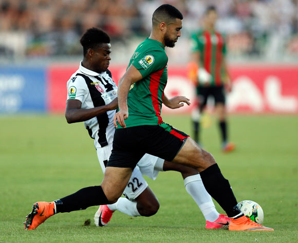 Club Sportif Sfaxien player Serigne Fallou Niang (R) fights for the ball with Mouloudia Club D'Alger player Rachid Bouhenna  (L) during the 2017 CAF Confederations Cup game between Sfaxien and Mouloudia Club D'Alger in Sfax, Tunisia on 8 July 2017 © BackpagePix