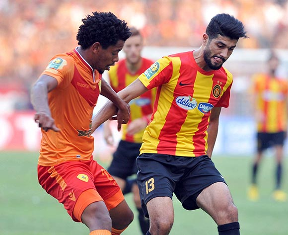 Esperance Sportive de Tunis player  SassiFerjani  (R) fights for the ball with Saint George S.C. player Zerihun  Deressie  (L) during the 2017 CAF Champions League game between Esperance and Saint George Tunis, Tunisia on 9 July 2017 © BackpagePix