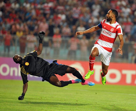 Club Africain player Saber Khalifa  (R) fights for the ball with Kampala City Council FC goalkeeper Benjamin Ochan (L) during the 2017 CAF Confederations Cup game between Club Africain and  Kampala City Council FC at Stade Olympique Rades in Tunis, Tunisia on 07 July 2017 © BackpagePix