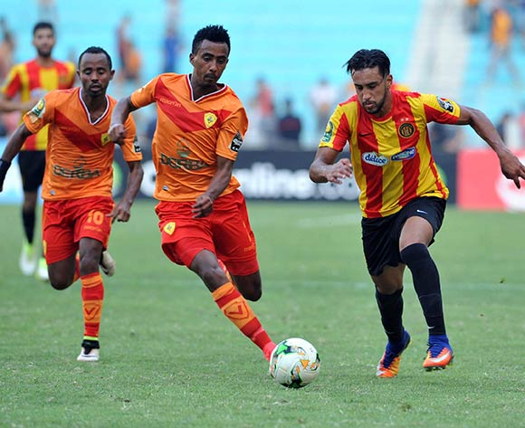 Esperance Sportive de Tunis player  Mejri Bilel  (R) fights for the ball with Saint George S.C. player Frezer Kasa (C) during the 2017 CAF Champions League game between Esperance and Saint George Tunis, Tunisia on 9 July 2017 © BackpagePix