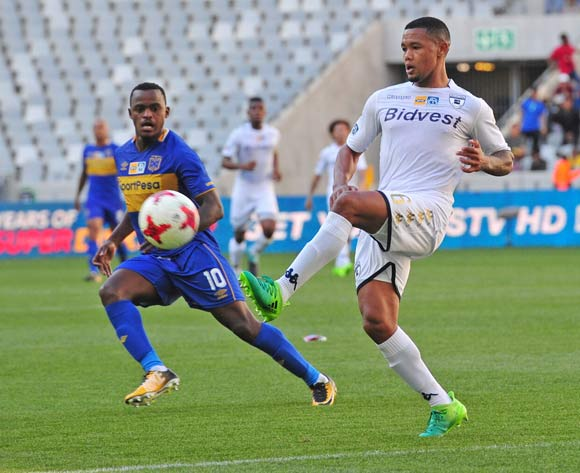 Granwald Scott of Bidvest Wits gets to the ball ahead of Ayanda Patosi of Cape Town City during the 2017 MTN8 Semifinal 1st leg fixture between Cape Town City and Bidvest Wits at Cape Town Stadium on 27 August 2017 © Ryan Wilkisky/BackpagePix