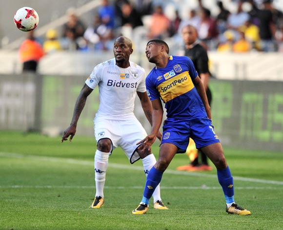 Lyle Lakay of Cape Town City flicks the ball past Sifiso Hlanti of Bidvest Wits during the 2017 MTN8 Semifinal 1st leg fixture between Cape Town City and Bidvest Wits at Cape Town Stadium on 27 August 2017 © Ryan Wilkisky/BackpagePix