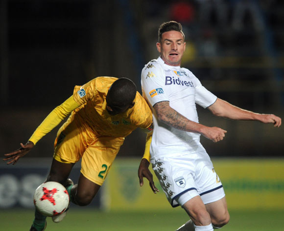 James Keene of Bidvest Wits challenges Nkanyiso Mngwengwe of Golden Arrows during the MTN8 quarterfinal match between Bidvest Wits and Golden Arrows on the 11 August 2017 at Bidvest Stadium © Sydney Mahlangu /BackpagePix