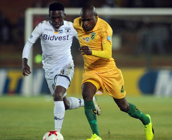 Thabang Monare of Bidvest Wits challenges Lerato Lamola of Golden Arrows during the MTN8 quarterfinal match between Bidvest Wits and Golden Arrows on the 11 August 2017 at Bidvest Stadium © Sydney Mahlangu /BackpagePix