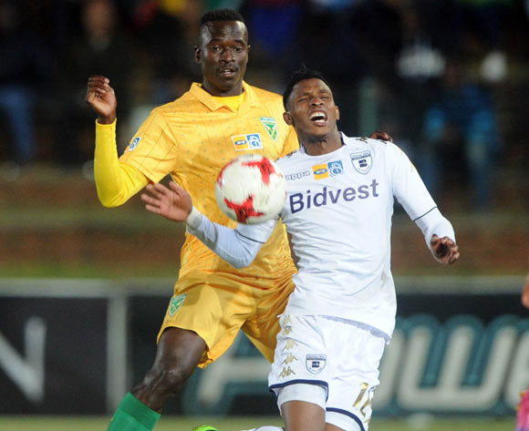 Vincent Pule of Bidvest Wits is challenged by Limbikani Mzava of Golden Arrows during the MTN8 quarterfinal match between Bidvest Wits and Golden Arrows on the 11 August 2017 at Bidvest Stadium © Sydney Mahlangu /BackpagePix