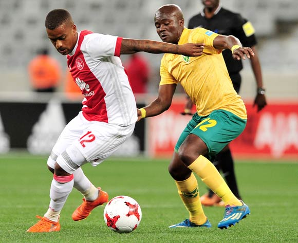 Erwin Isaacs of Ajax Cape Town turns away from Vuyani Ntanga of Golden Arrows during the Absa Premiership 2017/18 game between Ajax Cape Town and Golden Arrows  a Cape Town Stadium on 19 August 2017 © Ryan Wilkisky/BackpagePix