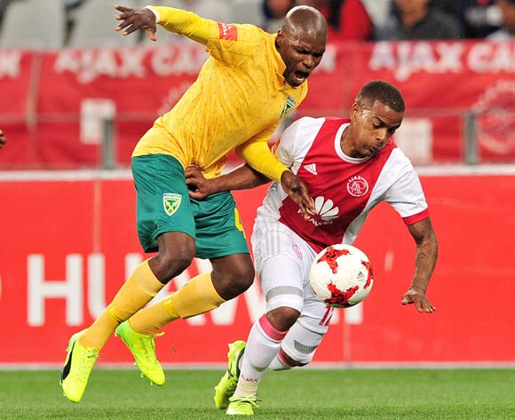 Lerato Lamola of Golden Arrows takes on Erwin Isaacs of Ajax Cape Town during the Absa Premiership 2017/18 game between Ajax Cape Town and Golden Arrows  a Cape Town Stadium on 19 August 2017 © Ryan Wilkisky/BackpagePix