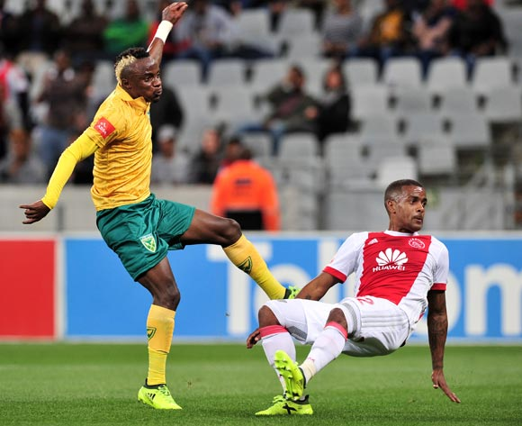 Kudakwashe Mahachi of Golden Arrows shoots at goal as he is challenged by Erwin Isaacs of Ajax Cape Town during the Absa Premiership 2017/18 game between Ajax Cape Town and Golden Arrows  a Cape Town Stadium on 19 August 2017 © Ryan Wilkisky/BackpagePix