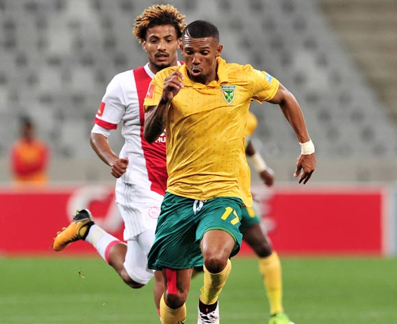 Wayde Jooste of Golden Arrows gives chase ahead of Rivaldo Coetzee of Ajax Cape Town during the Absa Premiership 2017/18 game between Ajax Cape Town and Golden Arrows  a Cape Town Stadium on 19 August 2017 © Ryan Wilkisky/BackpagePix