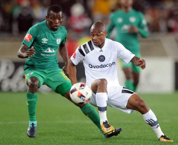 Thabo Qalinge of Orlando Pirates is challenged by Albert Mothupa of Baroka FC during the Absa Premiership match between Baroka FC and Orlando Pirates on the 22 August 2017 at Peter Mokaba Stadium © Sydney Mahlangu /BackpagePix