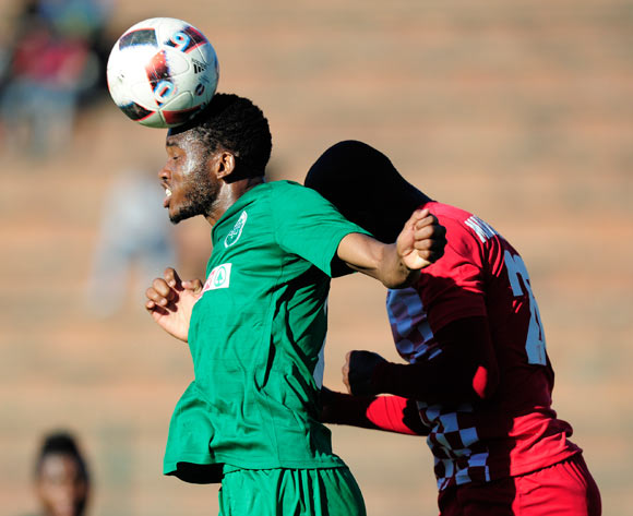 Ovidy Karuru of AmaZulu FC gets to the ball before Rooi Mahamutsa of Free State Stars FC during the Absa Premiership 2017/18 game between AmaZulu and Free State Stars at King Zwelithini Stadium, Durban on 19 August 2017 © Gerhard Duraan/BackpagePix