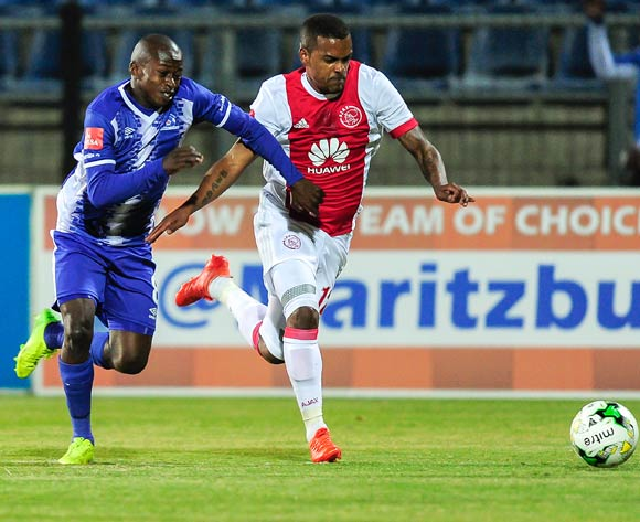 Siphesihle Ndlovu of Maritzburg United  and Erwin Isaacs of Ajax Cape Town F.C. fight to get to the ball first during the Absa Premiership 2017/18 game between Maritzburg United and Ajax Cape Town at Harry Gwala Stadium, Pietermaritzburg on 23 August 2017 © Gerhard Duraan/BackpagePix