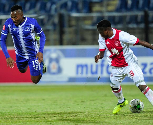 Ndiviwe Mdabuka of Ajax Cape Town F.C. sends Lebohang Maboe of Maritzburg United flying as he defends the ball during the Absa Premiership 2017/18 game between Maritzburg United and Ajax Cape Town at Harry Gwala Stadium, Pietermaritzburg on 23 August 2017 © Gerhard Duraan/BackpagePix