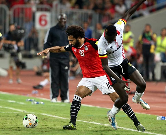epa06186696 Egyptian player Mohamed Salah  (L) in action against Uganda player Joseph Ochaya (R) during the FIFA World Cup 2018 qualifying soccer match between Egypt and Uganda at Borg Al Arab stadium in Alexandria, Egypt, 05 September 2017  EPA/KHALED ELFIQI
