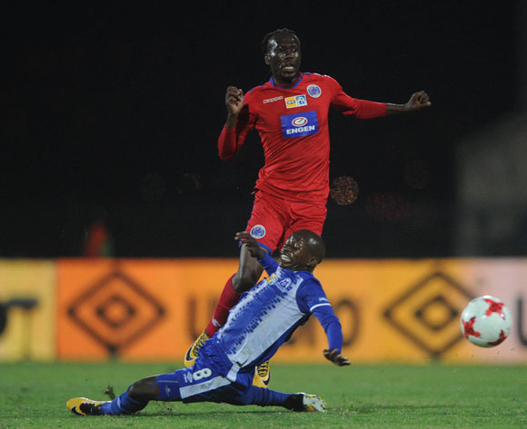 Reneilwe Letsholonyane of Supersport United is challenged by Siphesihle Ndlovu of Maritzburg United during the MTN8 Semi Final Second Leg match between Maritzburg United and Supersport United  on the 09 September 2017 at Harry Gwala Stadium  © Sydney Mahlangu /BackpagePix