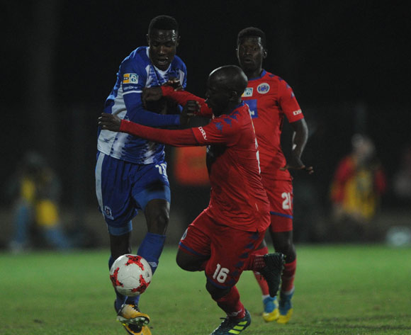 Aubrey Modiba of Supersport United challenges Evans Rusike of Maritzburg United  during the MTN8 Semi Final Second Leg match between Maritzburg United and Supersport United  on the 09 September 2017 at Harry Gwala Stadium  © Sydney Mahlangu /BackpagePix