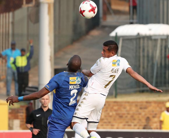 Daine Klate of Bidvest Wits wins header against Thamsanqa Mkhize of Cape Town City during the 2017 MTN8 semifinal football match between Bidvest Wits and Cape Town City at Bidvest Stadium, Johannesburg on 10 September 2017 ©Gavin Barker/BackpagePix