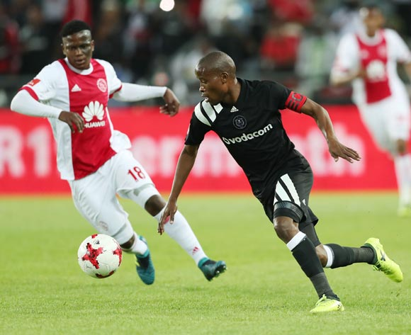 Thabo Matlaba of Orlando Pirates evades tackle from Ndiviwe Mdabuka of Ajax Cape Town during the 2017/18 Absa Premiership football match between Orlando Pirates and Ajax Cape Town at Orlando Stadium, Johannesburg on 12 September 2017 ©Gavin Barker/BackpagePix