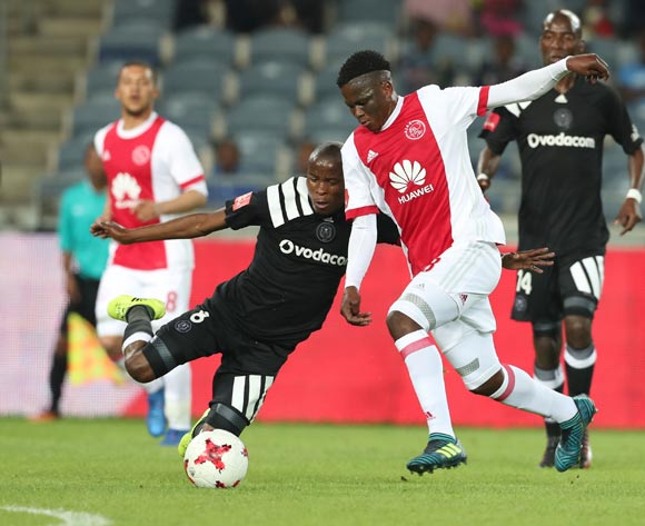 Thabo Matlaba of Orlando Pirates tackles Ndiviwe Mdabuka of Ajax Cape Town during the 2017/18 Absa Premiership football match between Orlando Pirates and Ajax Cape Town at Orlando Stadium, Johannesburg on 12 September 2017 ©Gavin Barker/BackpagePix