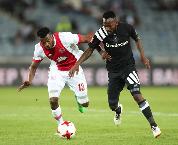 Mpho Makola of Orlando Pirates challenged by Isaac Nhlapo of Ajax Cape Town during the 2017/18 Absa Premiership football match between Orlando Pirates and Ajax Cape Town at Orlando Stadium, Johannesburg on 12 September 2017 ©Gavin Barker/BackpagePix