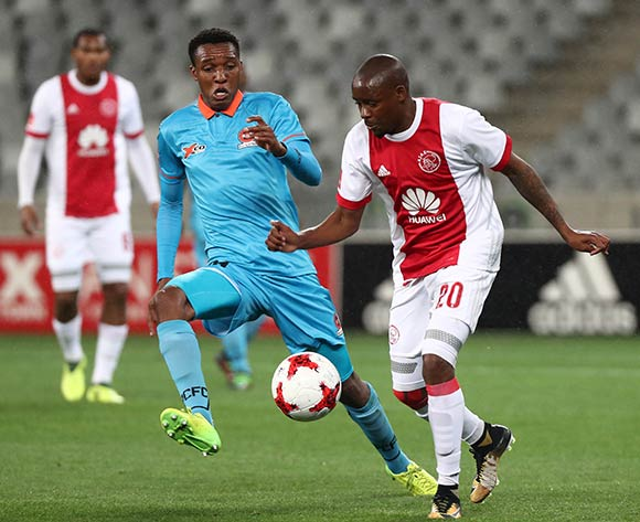 Bantu Mzwakali of Ajax Cape Town evades challenge from Sammy Seabi of Polokwane City during the Absa Premiership 2017/18 football match between Ajax Cape Town and Polokwane City at Cape Town Stadium, Cape Town on 15 September 2017 ©Chris Ricco/BackpagePix