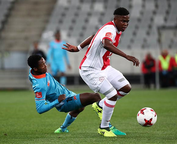 Ndiviwe Mdabuka of Ajax Cape Town tackled by Thabang Klaas of Polokwane City during the Absa Premiership 2017/18 football match between Ajax Cape Town and Polokwane City at Cape Town Stadium, Cape Town on 15 September 2017 ©Chris Ricco/BackpagePix