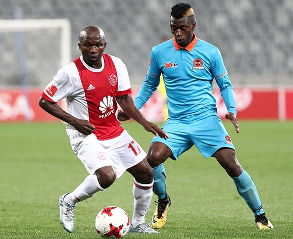 Ejike Uzoenyi of Ajax Cape Town evades challenge from Walter Musona of Polokwane City during the Absa Premiership 2017/18 football match between Ajax Cape Town and Polokwane City at Cape Town Stadium, Cape Town on 15 September 2017 ©Chris Ricco/BackpagePix