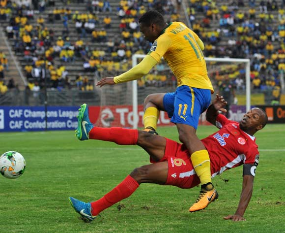 Sibusiso Vilakazi of Mamelodi Sundowns challenged by Brahim Nakach of Wydad Athletic during 2017 Caf Champions League game between Mamelodi Sundowns and Wydad AC at Lucas Moripe Stadium on 17 September 2017@Aubrey Kgakatsi/BackpagePix