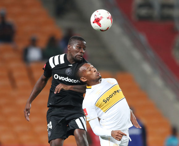 Ntsikelelo Nyauza of Orlando Pirates wins header against Lehlohonolo Majoro of Cape Town City during the 2017/18 Absa Premiership football match between Orlando Pirates and Cape Town City at Soccer City, Johannesburg on 19 September 2017 ©Gavin Barker/BackpagePix
