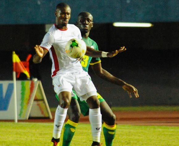 Nakoulma Nguibe Prejuce from Burkkna Faso ( front of ) vies for the ball with Alfred  Ndiaye from senegal ( Behind )  ) during theiir match 2018 fifa World Cup Russia Qualifying Match Senegal vs Burkinafaso At Stadium Leopold Sedar Senghor  Dakar  , Senegal,  2 September