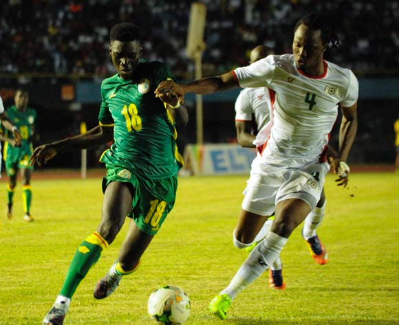 Ismaila Sarr from senegal ( L ) vies for the ball with Kone Bakarye from Burkina Faso ( R  ) during theiir match 2018 fifa World Cup Russia Qualifying Match Senegal vs Burkinafaso At Stadium Leopold Sedar Senghor  Dakar  , Senegal,  2 September